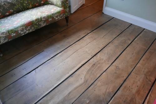Neoprene sponge cord to prevent floorboard drafts